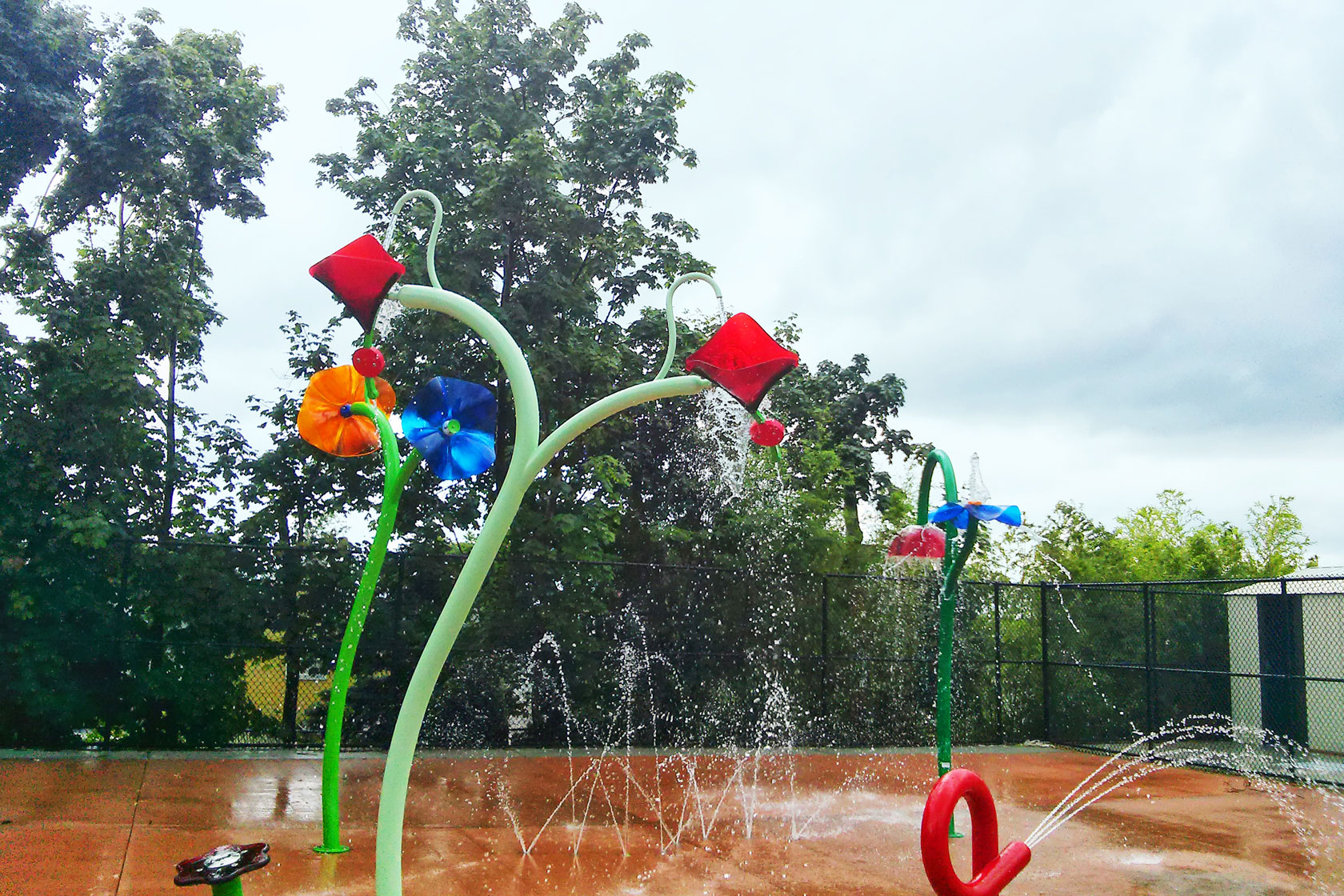 The 1805 square foot columbus spray park is made up of two pods that together have three zones individually designed for families teens and toddlers